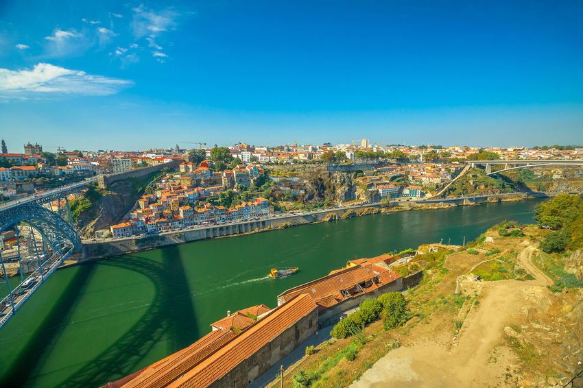 Picturesque Oporto urban landscape. Aerial view of Dom Luis I on Douro River and city skyline, Vila Nova de Gaia, Porto in Portugal. Sunny beautiful day. Portugal Porto Tourism City Aerial View Cloudscape Cityscape Landscape Panorama Europe People Church Church Architecture Architecture Town Porto Portugal 🇵🇹 Monment Oporto City Oporto Downtown Oporto Streets Douro River Portugal River Sea Bridge Built Structure Building Exterior Water Sky Transportation Nature High Angle View Bridge - Man Made Structure Connection No People Day Outdoors Building
