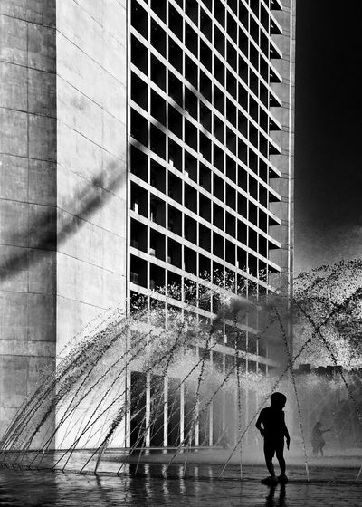 Architecture Black And White Building Exterior Built Structure Child City Day Fountain Full Length Lifestyles One Person Outdoors People Play Real People Reflection Silhouette Streetphotography Walking The Street Photographer - 2017 EyeEm Awards The Architect - 2017 EyeEm Awards Black And White Friday