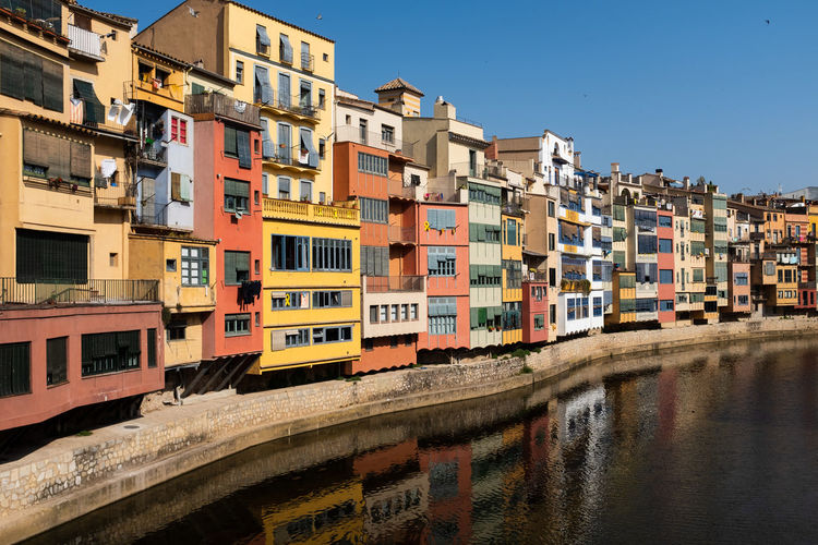 Gerona, spain, multicolored houses in the old town with their charming reflections in the river.