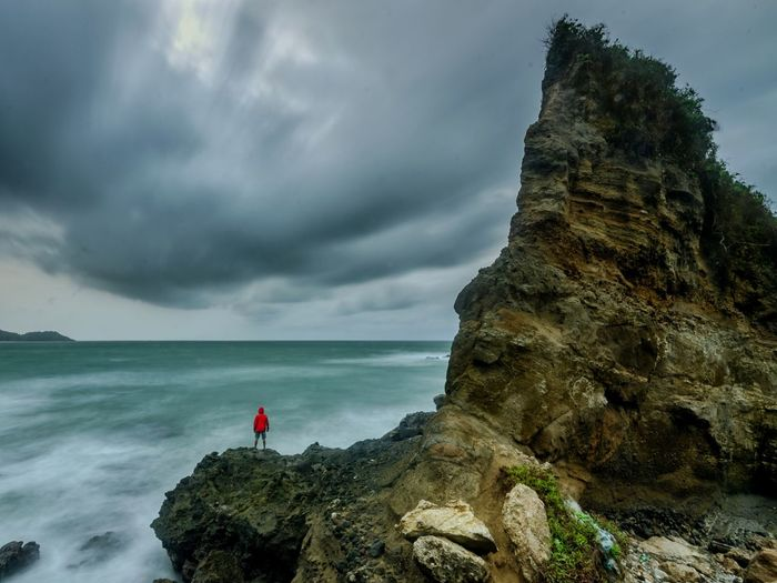 Rock - Object Sea Beach One Person Dramatic Sky Adult Full Length Landscape People Nature Adventure One Man Only Horizon Over Water Ethereal Awe Adults Only Cloud - Sky Exploration Outdoors Cliff VSCO Motion Fullframe NoEdits  Only Men