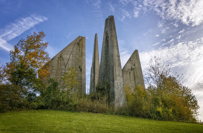 """Friedland - """"Heimkehrer-Denkmal"""" Architecture Built Structure Cloud - Sky Day Friedland Friedland Gedächtnisstätte Gemeinde Friedland History Low Angle View Mahnmal Memorial Nature No People Outdoors Sky Travel Destinations Tree"""