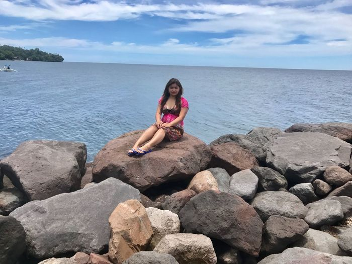 Sea Sky Real People Full Length One Person Leisure Activity Cloud - Sky Rock - Object Water Lifestyles Nature Outdoors Beauty In Nature Horizon Over Water Day Scenics Young Women Beach Young Adult Camiguin Philippines White Island