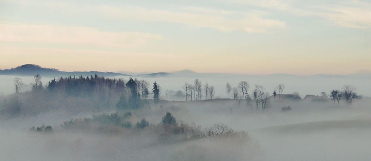 Panoramic View Of Mountains Against Sky During Foggy Weather
