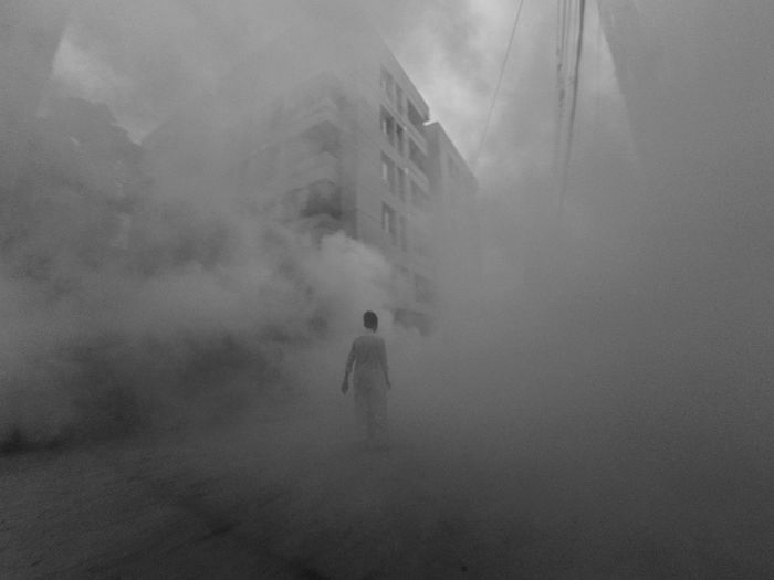 Municipal's worker was spreading mosquito killing smoke. Some people were trapped in the smoke like this. Dhaka Dhaka Street 999 Bangladesh Smoke Mosquito Man Building Black & White Xiaomi YI Action Monochrome Fog Real People People Unrecognizable Person Smoke - Physical Structure Leisure Activity Day Environment Nature Men Lifestyles Outdoors Landscape Walking Beauty In Nature Rear View Full Length Standing First Eyeem Photo My Best Photo The Art Of Street Photography