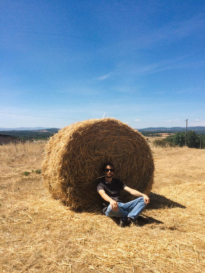 Portugal Rural Agriculture Bale  Blue Clear Sky Day Field Full Length Grass Hay Hay Bale Haystack Landscape Men Nature One Person Outdoors People Real People Sitting Sky Straw Young Adult