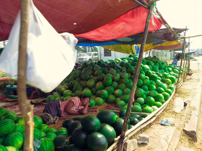 When we first arrived in Laos I was stunned - quite literally - just how many watermelons were being sold at the roadside. Living in Thailand I was no stranger to fresh fruit, but this was something else. I was in awe, mouth wide open as we walked past stacks and stacks and stalls and stalls of big, green juicy watermelons! Architecture Arrangement Choice Close-up Day For Sale Freshness Fruit Laos Market Market Stall Outdoors Retail  Variation Watermelon My Year My View The Photojournalist - 2017 EyeEm Awards