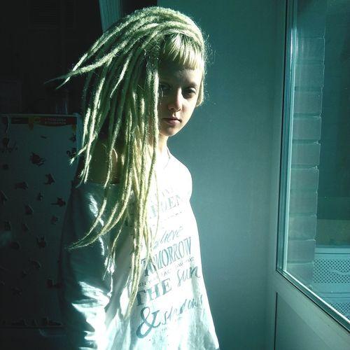 Young Women Young Adult Person Casual Clothing Long Hair Three Quarter Length Indoors  Standing Blond Hair Confidence  Beauty Loneliness Dreadgirl Dreadhead DreadLife Dreads Dreadlove Dreadlocks Looking At Camera Sunlight Window