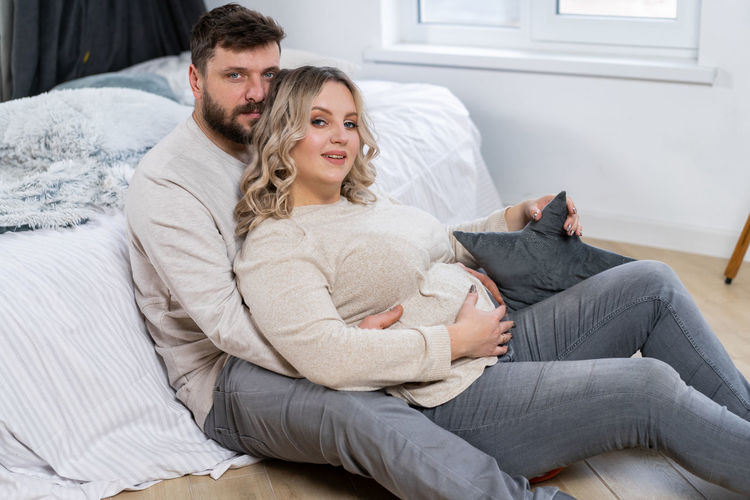 Young couple sitting at home