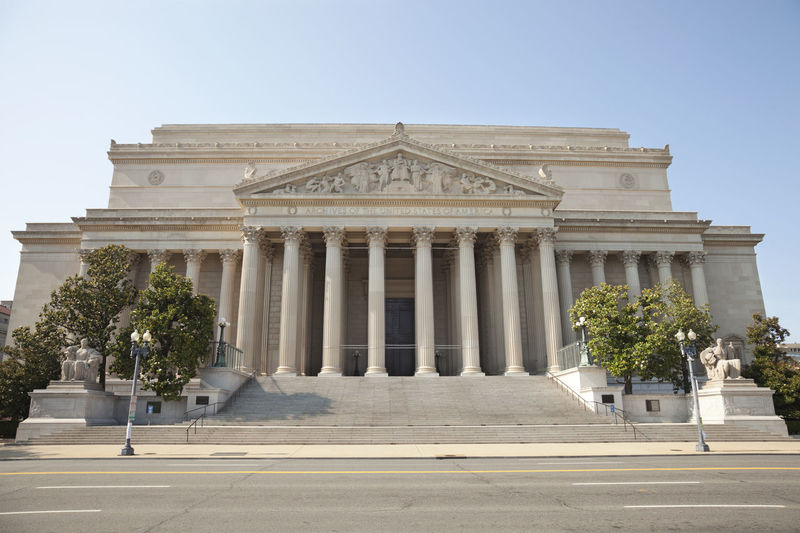 National archives building against clear sky in city