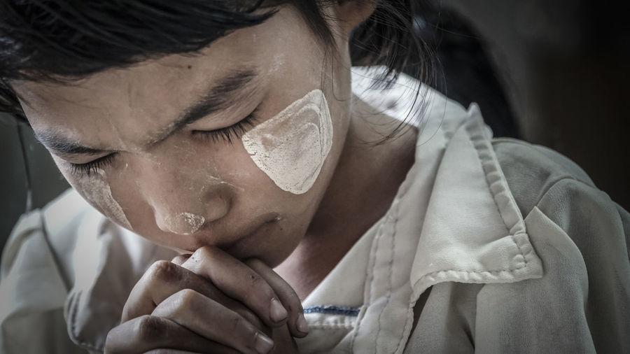 Close-up of girl praying