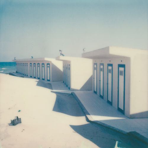 Film Photography Analogue Photography Polaroid Absence Architecture Beach Building Building Exterior Built Structure Clear Sky Copy Space Day Empty Lighting Equipment Nature No People Outdoors Railing Shadow Sky Sunlight Wall White