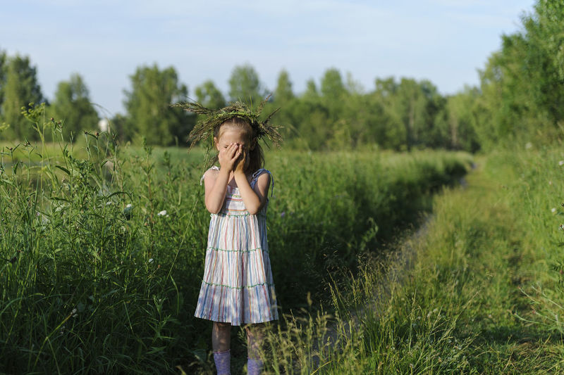 Plant Three Quarter Length Land One Person Grass Standing Landscape Field Nature Agriculture Childhood Girls Day Green Color Child Dress Emotion Smiling Rural Scene Hair Hairstyle Innocence Outdoors
