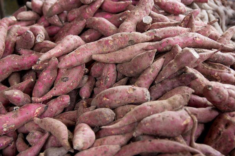 Full frame shot of sweet potatoes for sale at market stall