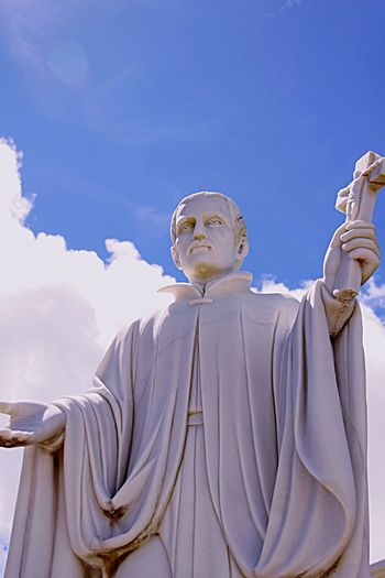 Low Angle View Of Religious Statue Against The Sky
