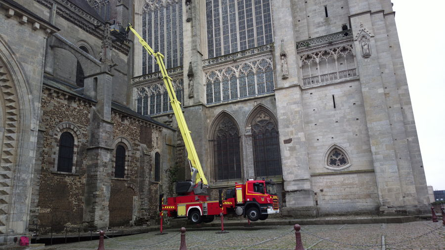 Cherry picker by historic building