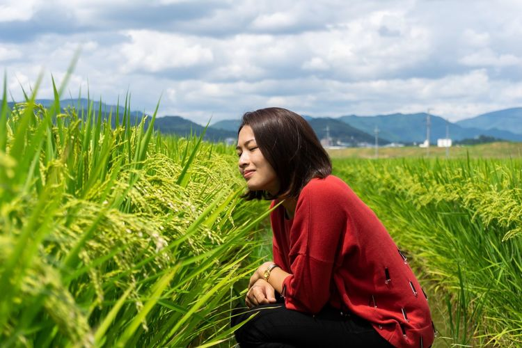 Very freshness. Freshness Happiness Japan Portrait Of A Woman Travel Abundance Beautiful Woman Beauty In Nature Cloud - Sky Countryside Field Growth Leisure Activity Lifestyles Nature One Person Plant Portrait Rice Field Scenics - Nature Sitting Sky Smelling Women Young Adult