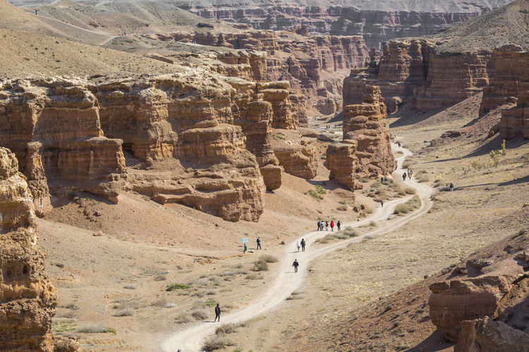 Panoramic view of people on rock formations