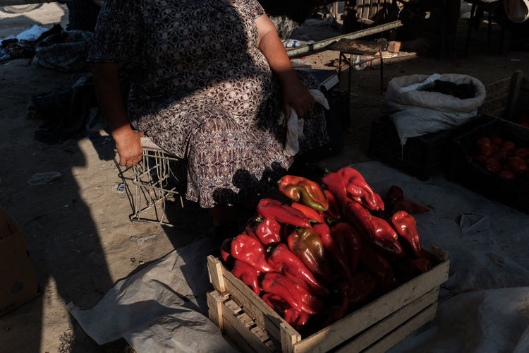 High angle view of paprika in crate at market