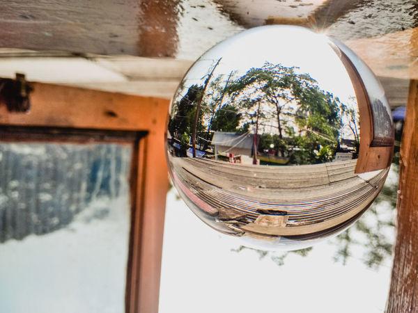 View of a glass ball Glass Ball Crystal Ball Lens Ball Outdoor Glass EyeEm EyeEm Best Shots EyeEm Selects EyeEmNewHere EyeEm Gallery Eyeemphotography Jakarta INDONESIA Water Tree Swimming Pool Reflection Close-up Sky Architecture