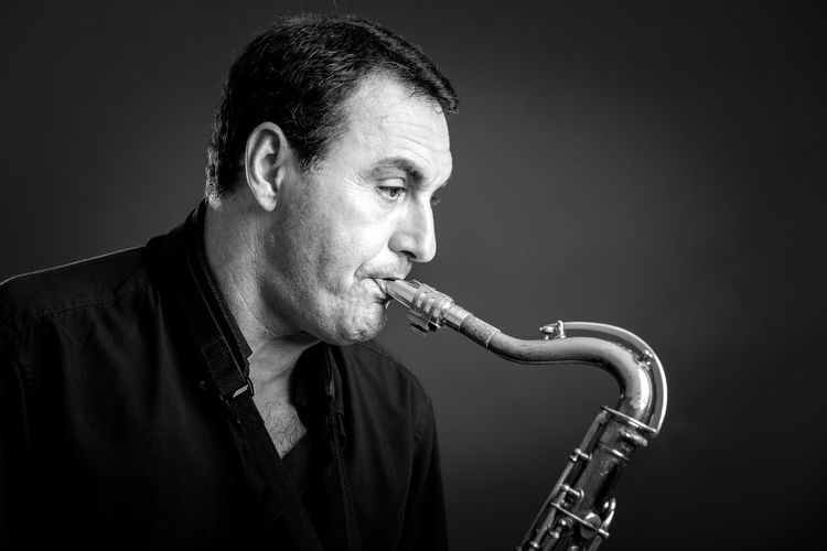 Man playing saxophone in the studio. Adult Adults Only Black And White Blackandwhite Photography Indoors  Jazz Music Mature Adult Mature Men Music Musical Instrument Musician One Man Only One Mature Man Only One Person Only Men People Playing Portrait Real People Saxophone Studio Shot Wind Instrument