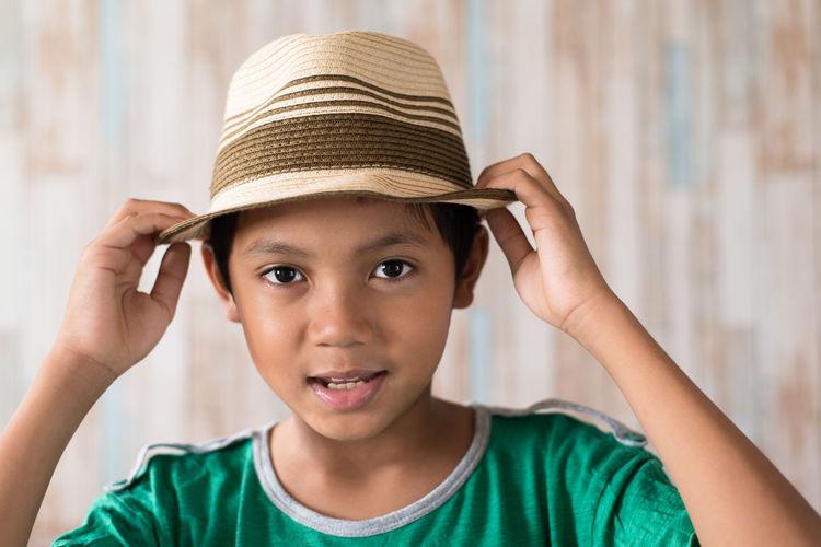Portrait of cute boy wearing hat