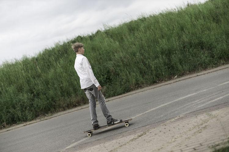 Young boy on longboard