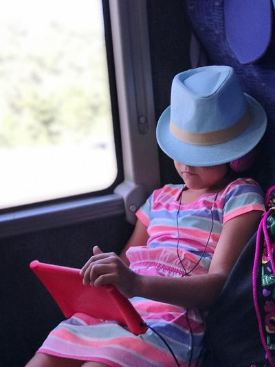 Ipad Traveler Traveling Trip Window Childhood One Person Child Sitting Vehicle Interior Mode Of Transportation Girls Hat Transportation Offspring Public Transportation Casual Clothing Real People Females It's About The Journey