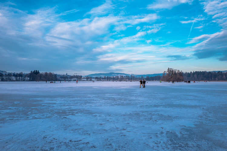 Beauty In Nature Blue City Cold Temperature Day Frozen Frozen Water Ice Ice Rink Ice-skating Landscape Mauensee Nature One Person Outdoors People Scenics Sky Snow Switzerland Travel Destinations Urban Skyline Winter Winter Sport