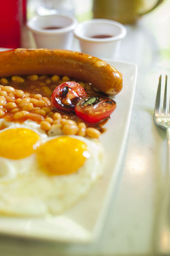 Close-up of english breakfast served in plate