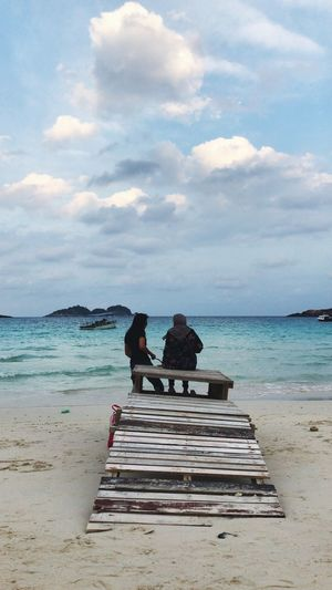 Crystal blue ocean Rusticwood Redangisland Island Beautiful Nature Crystalbluewater Crystalblue Sea Beach Water Sky Land Cloud - Sky Real People Sitting Beauty In Nature Scenics - Nature Nature Adult Outdoors Women Two People Day Tranquility