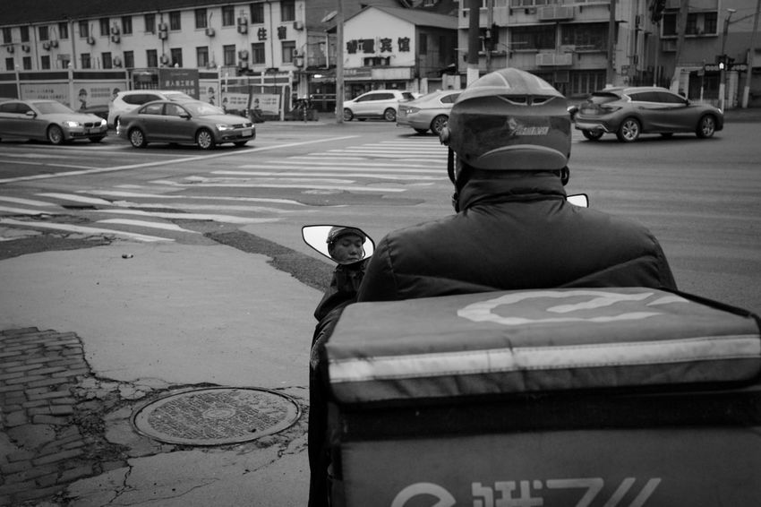 Mode Of Transportation Car City Motor Vehicle Transportation Land Vehicle Architecture Street Building Exterior Built Structure Rear View Men Real People Day Incidental People One Person City Life Clothing City Street Streetphotography Blackandwhite
