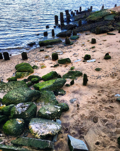 East River Beauty In Nature Blue Water Day East River, NYC Green Nature No People Outdoors Pier River Rock - Object Sand Water