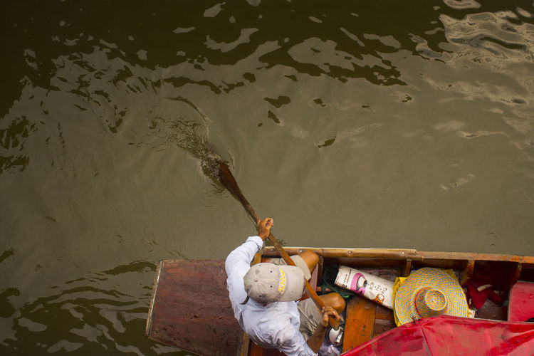 High angle view of man on boat in lake