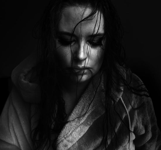 Indoors  Long Hair Headshot Young Adult Person Young Women Front View Casual Clothing Beauty Dark Messy Studio Shot Black Background Straight Hair Woman Serious Portrait Contemplation Close-up Solitude Emotion Loneliness Dark People Depression