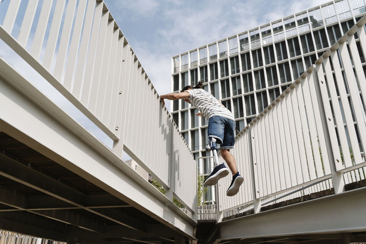 Low angle view of man jumping on building