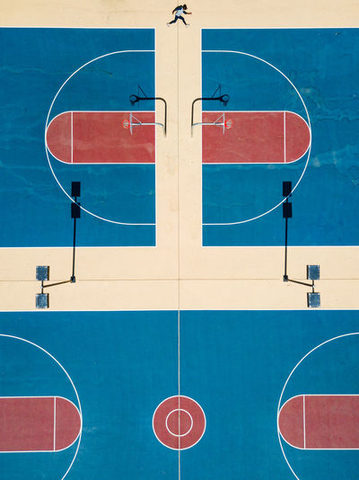 High angle view of basketball hoop against blue sky