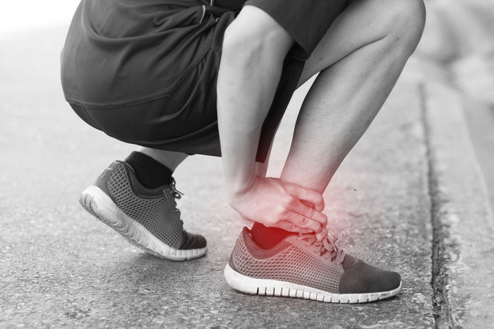 Man Pain Running Adult Ankle Close-up Day Fitness Human Body Part Human Leg Injury Jogger Jogging Lifestyles Low Section Male One Person Outdoors Painful People Real People Runner Shoes Sport Sprain