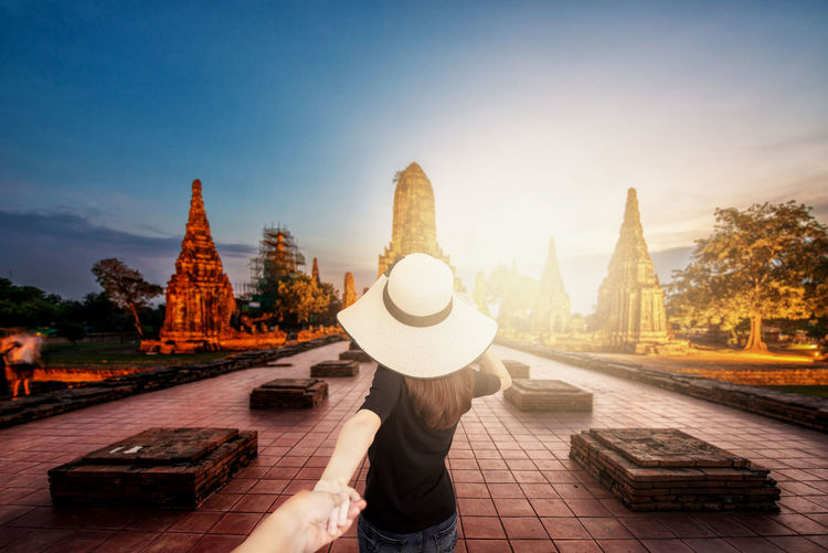 Rear view of woman in temple against sky