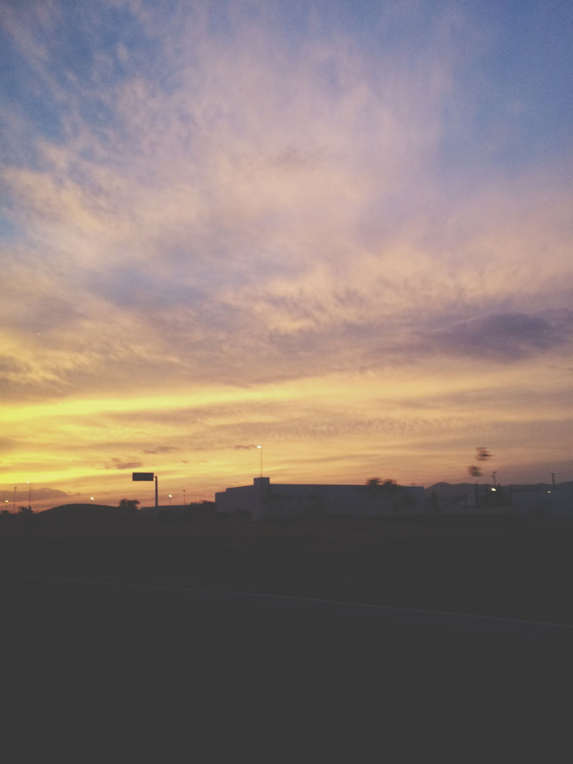sunset, sky, silhouette, orange color, building exterior, cloud - sky, architecture, built structure, scenics, beauty in nature, nature, cloud, tranquility, dusk, cloudy, tranquil scene, outdoors, dramatic sky, no people, idyllic
