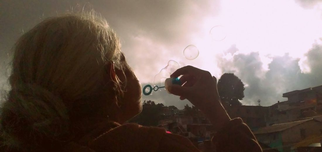 Going back to being a kid again. PhonePhotography Grandma Bubbles Blowing Bubbles Happy People Sunset Playing Around!  The Week On Eyem Glitch My Best Photo 2015