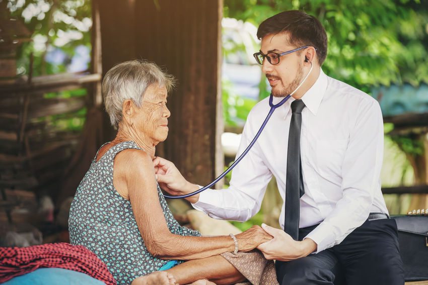 Family medicine visits the elderly woman in rural Care Country Doctor  Examination Family Home Hospital Man Medicine Rural Circulation Clinic Elderly Exam Health Heart Illness Medical Patient People Physician Professional Pulmonary Stethoscope  Visit