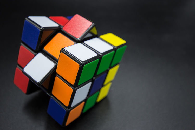 Multi Colored Indoors  Geometric Shape Studio Shot Close-up Still Life Toy Black Background Shape Toy Block Cube Shape Table Design No People Choice Variation High Angle View Wood - Material Copy Space Block Puzzle