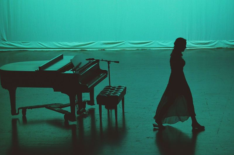 High Angle View Of Pianist Woman Walking By Piano On Stage