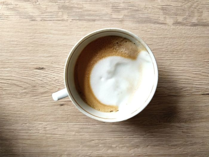 Almost forgot to take a picture of my coffee.. Directly Above Copy Space Relaxing Relaxation Waiting Berlin Morning Rituals Morning Circle Coffee - Drink Drink Coffee Cup Refreshment Directly Above Food And Drink Table Frothy Drink Latte Cappuccino High Angle View Indoors  Froth Art Wood - Material Coffee Break