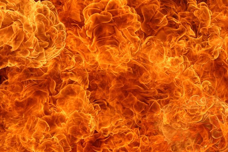 Close-up of orange fire against black background