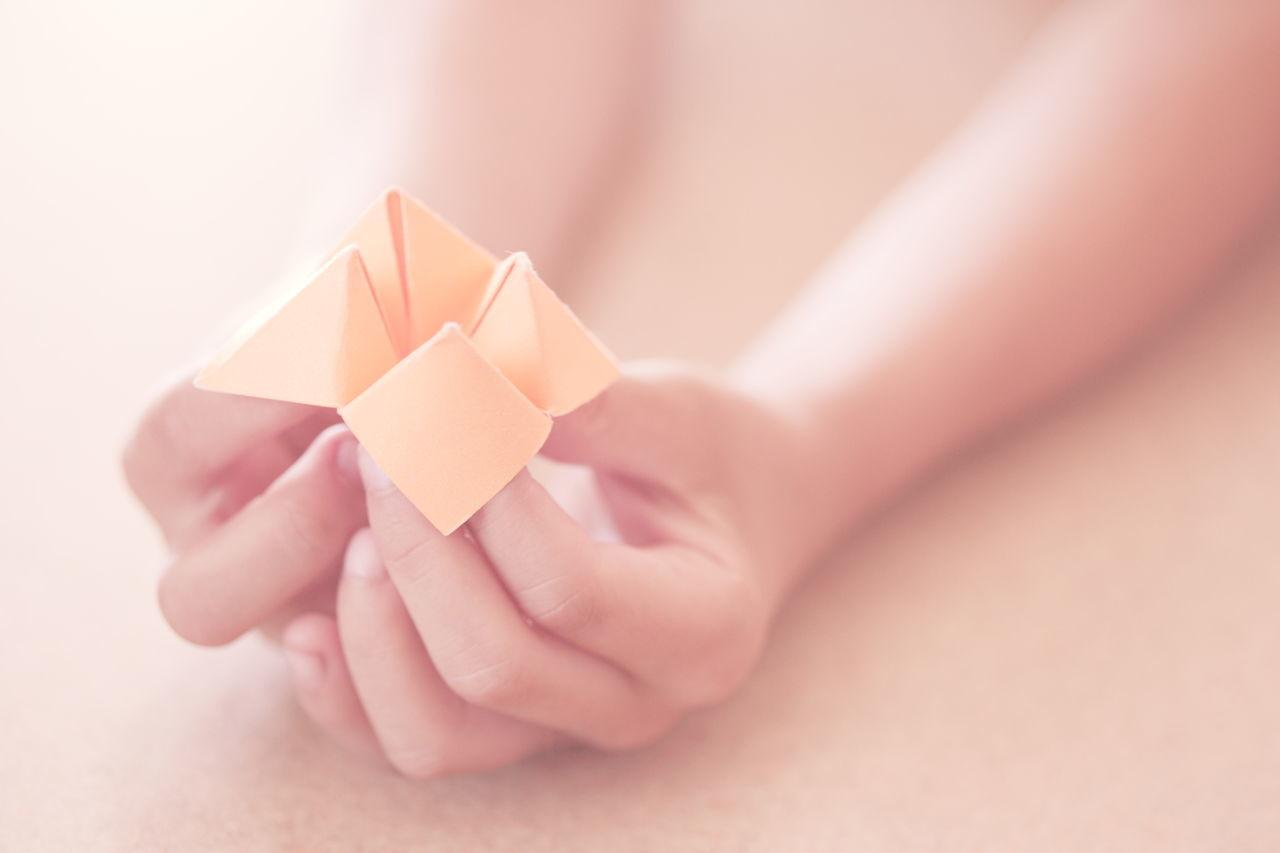 Human hand holding paper design