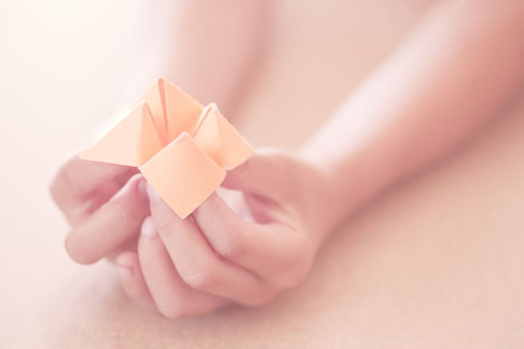 Human hand holding paper design