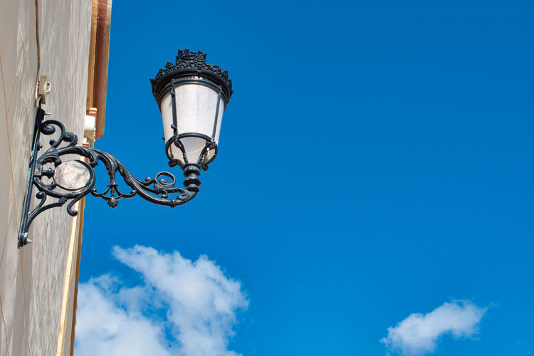 Sky Low Angle View Lighting Equipment Street Light Street Blue Nature Cloud - Sky No People Metal Day Architecture Electric Lamp Building Exterior Gas Light Electricity  Retro Styled Outdoors Built Structure Electrical Equipment
