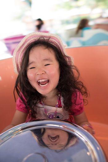 Cute Girl Enjoying At Amusement Park