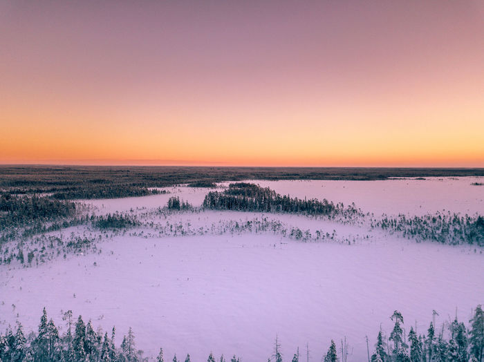 In the middle of nowhere Tranquility Tranquil Scene Sky Beauty In Nature Sunset Nature No People Clear Sky Orange Color Landscape Outdoors Purple High Angle View Drone  View From Above Wilderness Winter Snow Forest Tree Scenics Freshness Photography Hello World Explore